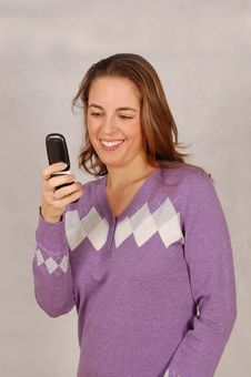 Young Woman Dialing Number On Her Cell Phone Royalty Free Stock Photo