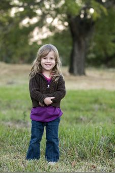 Girl In A Field Smiling Royalty Free Stock Image