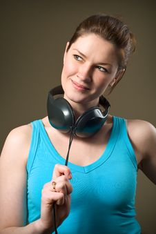 Free Beautiful Smiling Girl Wearing Music Headphones Royalty Free Stock Image - 8028626