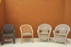 Free Colorful Straw Wicker Chairs On Patio Royalty Free Stock Photography - 8028717