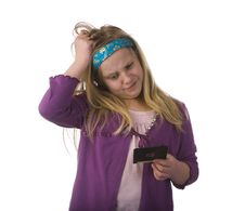 Free Young Girl Confused By Old Floppy Disc Stock Photography - 8028842