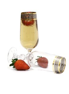 Free Glasses With Champagne And A Strawberry. Stock Photography - 8029082