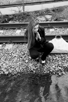 Free Girl Sitting Near Water Stock Images - 8029254