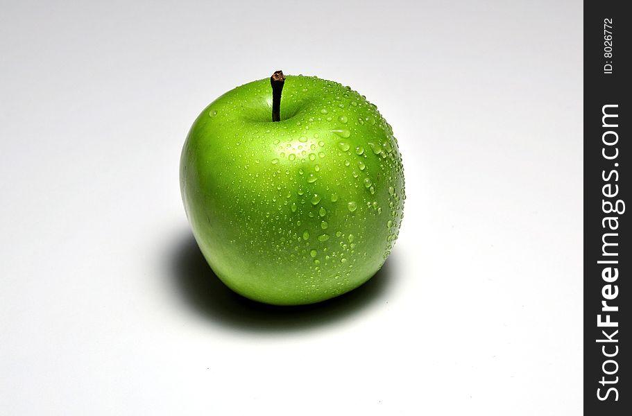 Wet Granny Smith apple