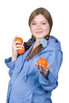 Fine Pregnant Woman In Blue Holding Three Oranges Royalty Free Stock Images
