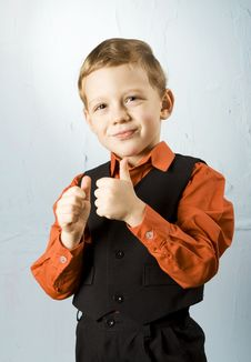 Boy Making Thumbs-up Sign Royalty Free Stock Photo