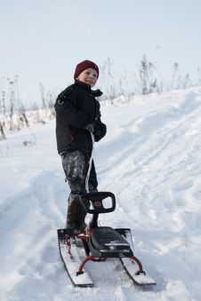 Free A Boy On The Sledge Royalty Free Stock Image - 8033136