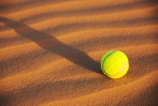 Free Tennis Ball In Sand Royalty Free Stock Photo - 8038615