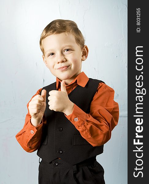 Boy making thumbs-up sign