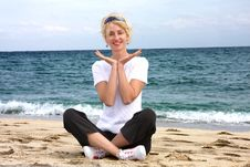 Free Girl Meditating By The Sea Stock Photo - 8040160