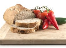 Sliced Whole Wheat Olive Bread And Peppers Royalty Free Stock Images