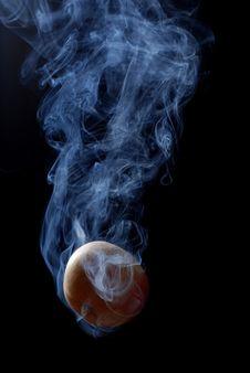 Yellow Apple And Smoke Stock Photo