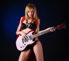 Woman With Electric Guitar Stock Photography