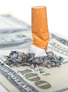 Free Cigarette Butt Laying On Money Royalty Free Stock Image - 8042046