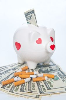 Free Piggybank And Cigarette Butts Standing On Money Royalty Free Stock Photo - 8042065
