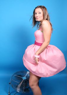 Free A Girl In Pink Dress And A Ventilator Stock Photography - 8044842