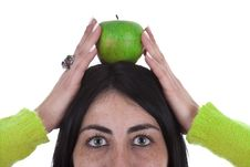 Free Woman Holding Healthy Green Apple Above The Head Stock Photo - 8050410