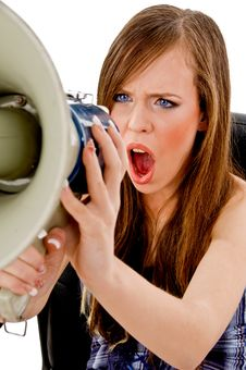 Front View Of Female Shouting In Loudspeaker Royalty Free Stock Images