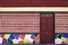 Colorful Tile And Dark Red Door Stock Photos