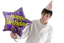 Young Man Holding Birthday Balloon Royalty Free Stock Photography