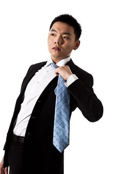 Free Asian Man In Formal Attire Untying Tie Stock Photography - 8053382