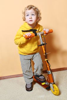Free Kid With Scooter. Stock Images - 8058484