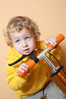 Kid With Scooter. Stock Photo