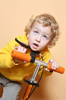 Kid With Scooter. Stock Photos