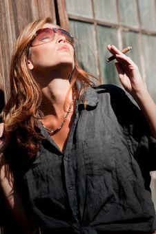 Free Young Woman Enjoying Sun And Cigar Stock Photography - 8059872