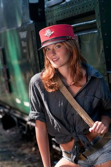 Young Woman With Conductor Cap Stock Photography
