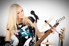 Free Rock-n-roll With The Beautiful Blonde Stock Photo - 8061250