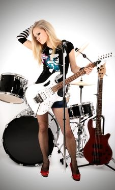 Free Rock-n-roll With The Beautiful Blonde Royalty Free Stock Image - 8061276
