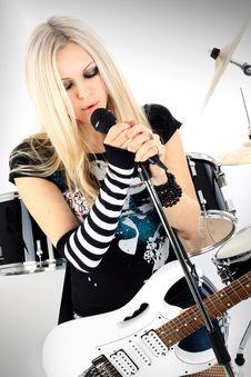 Free Rock-n-roll With The Beautiful Blonde Royalty Free Stock Photos - 8061288