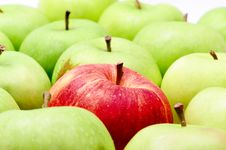 Free Red Apple In Green Apples Royalty Free Stock Photos - 8061378