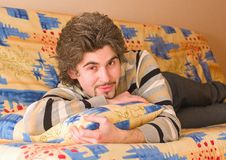 Young Handsome Male On Colourful Sofa Royalty Free Stock Image