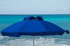 Free Blue Umbrella Against Blue Sea Stock Photography - 8062902