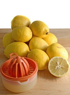 Free Organic Lemons And Juicer Royalty Free Stock Image - 8064336