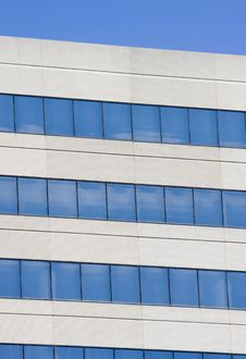 Free Blue Windows On Grey Concrete Royalty Free Stock Images - 8064499