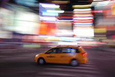 Free New York Yellow Taxi Speeding Through Times Square Stock Image - 8065881