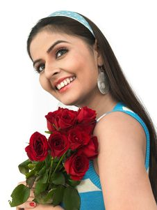 Woman With A Bouquet Of Red Roses Stock Photo