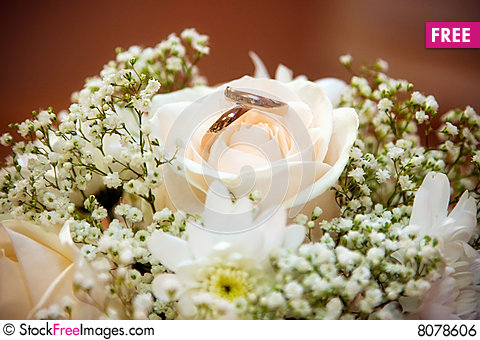 Wedding Rings In A Bouquet Of The Bride