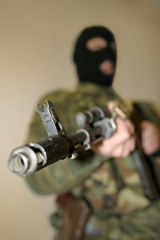 Person With Submachine Gun. Royalty Free Stock Image