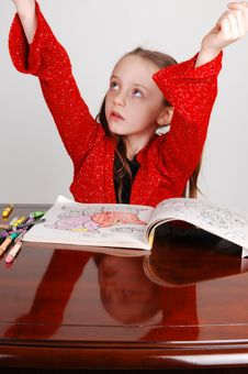 Little Girl Coloring. Stock Photo