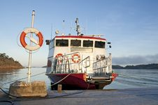 Lifebuoy And A Moored Ship Royalty Free Stock Photos