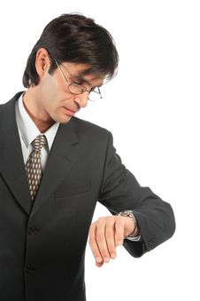 Businessman Looks At Watch