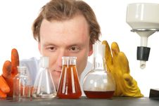 Free Chemist Looks On Flasks With Liquids Stock Images - 8074554