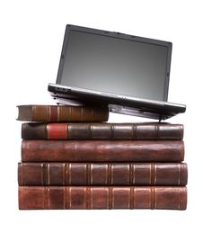 Old Leather Bound Books With A Laptop Stock Photography