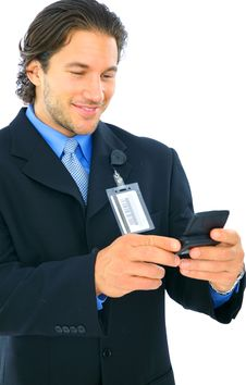 Smiling Young Caucasian Businessman Holding Pager Stock Images