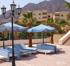Free Empty Deckchairs On Territory Of Hotel Stock Photography - 8079452