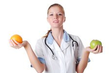 Free Nurse With Stethoscope And Fruits Stock Photography - 8080482